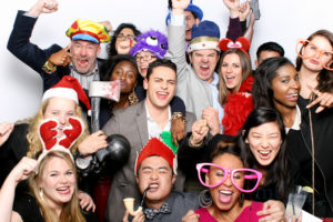 Group photo of people in a photobooth